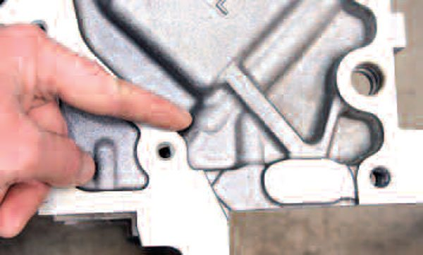 Another area to be concerned about is the bottoms of the head bolt holes. The inner ones are not as easy to see, but the rearmost ones are easily viewed at the back of the block. If an engine's cylinder heads had ever been removed and replaced (during service or high-performance upgrades), chances are that some coolant flowed into the head bolt holes. Failure to properly blow these holes out would cause hydraulic pressure to build when bolts are reinstalled, often resulting in block cracking in this area. Fortunately, this block is fine.