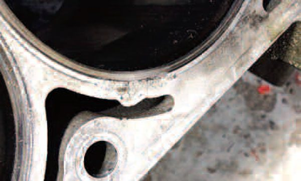 Other engine problems can lead to some less common block damage. For example, a leaky head gasket can cause hot combustion gases to seep between the block and head surfaces. With an aluminum block, these gases can actually melt the area just outside the iron cylinder liners, as seen here.