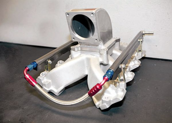 Here is an example of how the Edelbrock Victor Jr. intake manifold can be used in an EFI application: a 2000 Camaro SS with Strictly Performance–ported LS1 heads and a large camshaft. The sheet-metal elbows are from IntakeElbows. com, but Edelbrock has since come out with its own regular and low-profile elbows (which are cast aluminum). Though it does give up some torque down low, this setup improved over an LS6 by almost 40 hp at peak.