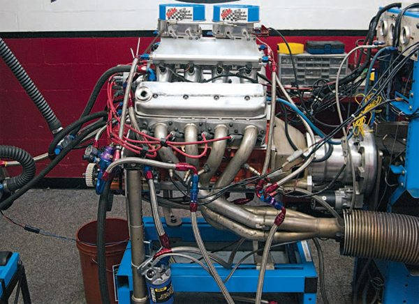 John Beck designed this manifold for the School of Automotive Machinists and its record-setting All Motor Camaro SS. This 433-ci LSX uses a 16:1 compression ratio and heavily worked C5R heads to make more than 1,000 hp at more than 9,000 rpm and run as fast as 8.2 in the quarter. A few different configurations of the intake have been used with either two 4-barrel throttle bodies or a single Braswell 7825. The latest version is composite on the upper half, where it meets the throttle body, and could help the Camaro become the first door-slammer to run 7s. (Photo Courtesy T.J. Atkins)