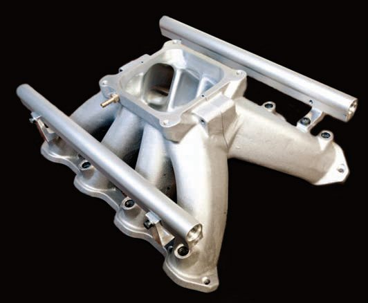 There has yet to be a better cast manifold than Mast's CNC two-piece intake. It's CAD-designed, CNC-machined, hand-finished, and hand-flowed before it leaves the factory. You can practically see your reflection inside the manifold, which is why this intake was later put on Late Model Race-craft's twin-turbo Outlaw Drag Radial Firehawk, which went 7.24 at 209 mph. Though it works on this 2,000-hp turbo application that spins more than 8,000 rpm, the Mast intake has also worked well for naturally aspirated combinations by making surprisingly great torque and power under the curve due to its long runners.  On another Late Model engine, this intake made 720 hp at 6,800 rpm on a big-cube, naturally aspirated motor, which was some 47 hp over the stock LS7.