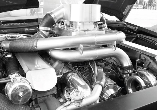 Turbo systems generate a lot of heat under the hood that can damage parts and promote detonation. This twin-turbo setup uses a number of thermal barriers and wraps on the exhaust system, fuel lines, and more. Such measures are relatively cheap insurance and help ensure engine longevity.