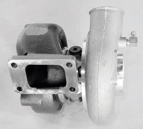 Turbochargers require no engine power to drive, and therefore are considerably more efficient than an engine-driven supercharger. However, boost only occurs when the engine RPM rises. At low speeds, particularly off idle, the turbocharger provides no power increase.