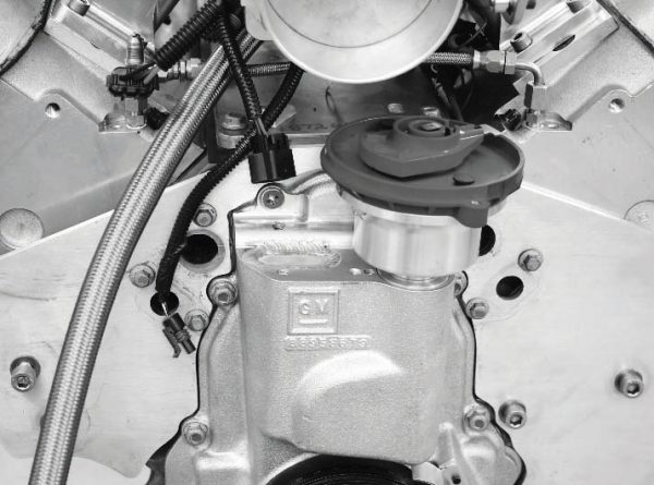 When the individual-coil system reaches its limit, the only alternative is conventional distributor-driven ignition system. GM Performance Parts offers the conversion kit, which mounts to the front of the engine, under PN 88958679. A conventional distributor, such as the front-mount type for a Ford Windsor small-block, is used with it.