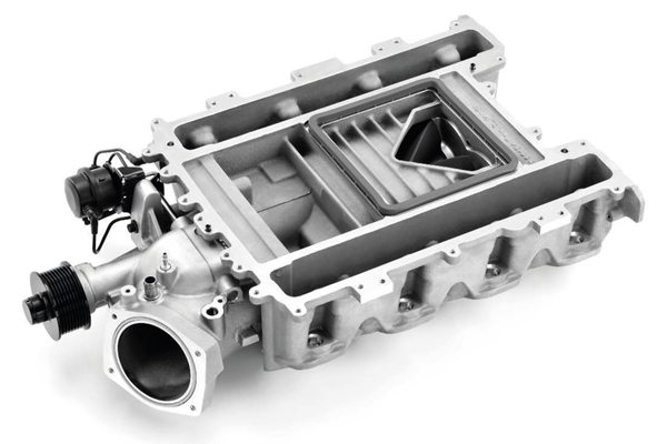 The supercharger cases of the LS9 and LSA incorporate dual brick-style heat exchangers for their respective intercooling systems. Here, the top section of the LSA's intercooler cover is removed, showing the triangular discharge port from the compressor. (Photo courtesy General Motors)