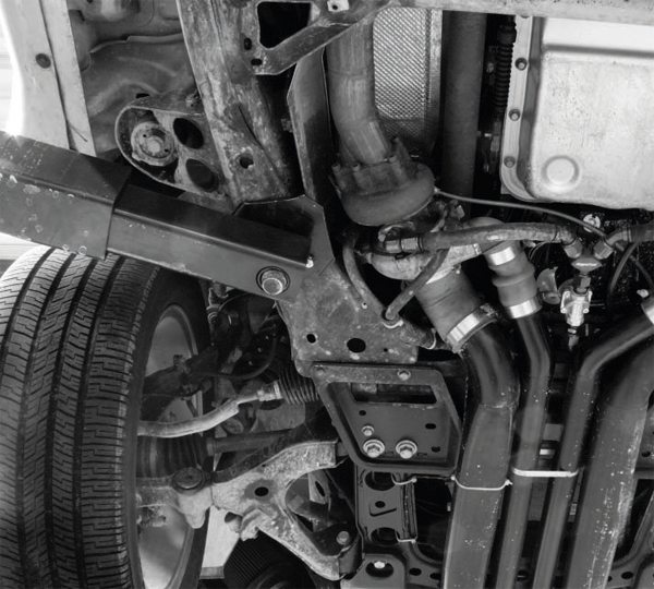 With most of the coolant and oil lines routed and connected, the turbos' air intake and discharge tubes are mounted. The relatively large chassis and generous ground clearance of the TrailBlazer SS allowed Stenod Performance to route them easily under the engine K-member, where they feed into the bottom of the intercooler heat exchanger.