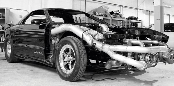 Here's another F-body with a turbo system adapted to it. But rather than squeezing a kit around the necessary factory chassis components of a street car, this drag-race car is essentially built around the turbo system. This design simplifies many of the installation procedures for the turbo system, but (as is clear from the photo) the car won't be suitable or street-legal for the street when completed.