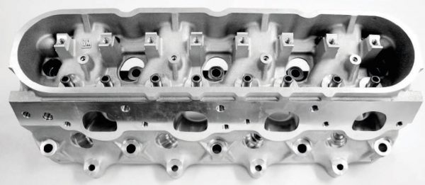 GM Performance Parts offers a range of LSX six-bolt cylinder heads with LS3/L92- and LS7- style rectangular ports, as well as an LSX-DR (drag race) head that offers raised runners, an 11-degree valve angle, and a design the requires shaft-mounted rocker arms. Taking advantage of the six-bolt clamping power, however, requires they be used with LSX or RHS six-bolt cylinder blocks. The standard LSX heads use standard LS intake manifolds, while the LSX-DR requires a unique, carburetorstyle manifold (PN 19166954) that can be adapted for use with racingoriented turbo and centrifugal supercharger systems.