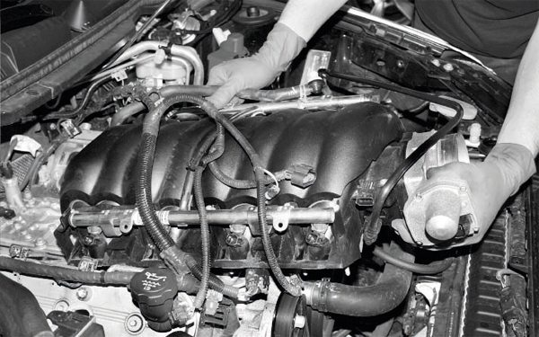 The intake manifold on most LSpowered vehicles is easily unbolted, although the comparatively restrictive engine compartments of fourthgeneration F-cars and the SSR can make access to the rear fasteners more of a challenge. After the disconnection of the fuel system, the airintake tract and a few miscellaneous hoses are pulled off, and the intake manifold should pull relatively easily off the top of the engine. The lightweight nylon construction of the manifold makes removal easy for one person, but that is not true when it comes to installing the supercharger/ intake manifold assembly. You should plan to have another person assist with that portion of the project.