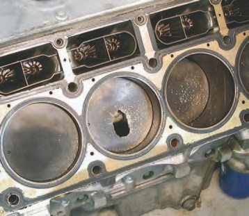 The hole in the factory aluminum piston in the number 4 hole on this LS6 engine is from the overuse of a 150-hp nitrous kit. Considering the temperature and detonation abuse it experienced, as shown by the speckled aluminum on the face of the piston, it's impressive that the piston just burned instead of completely shattering.