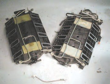 "Another way to identify the LS6-type intake (right) is by looking underneath it. The LS6 intake has a flat floor, while the LS1 style intake has a lot of shape, with a single hump down the length of the intake. Also, the LS6-and-later intakes have the square ribbing between their intake ports, while the early intakes have large ""x"" ribbing."