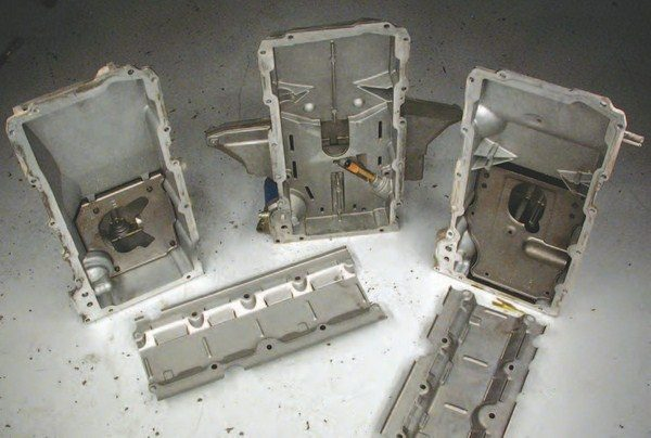All of the GM oil pans come with crank windage trays and oil containment trays to minimize oil wrapping around the crank and sloshing in the crankcase. Notice the F-body pan is shortened as it won't fit in the shallow front section of the pan, but the 'Vette and truck windage trays are full length.
