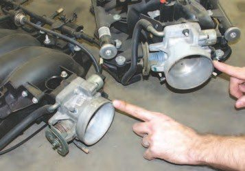 The early 75-mm LS1 throttle body (left) can be easily replaced with an 80-mm LQ4 throttle body (right) for an increase in airflow. The LS6 throttle bodies are 80 mm, but they are electronic throttle control (ETC), whereas the LQ4 throttle body is cable actuated.