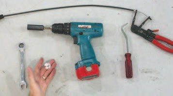The tools shown here will make the removal and reinstallation easier. The ratcheting open-end wrenches are for the fasteners in the tight areas. The radiator hook tool or angle pick is used to release the many electrical connector clips and hose clamps. A clutching cordless drill with a 3/8- inch drive will assist in removing the many smaller bolts, and the remote hose clamp depressor is a specialized tool that isn't required, but it helps out with some of the harder-toreach hose clamps.