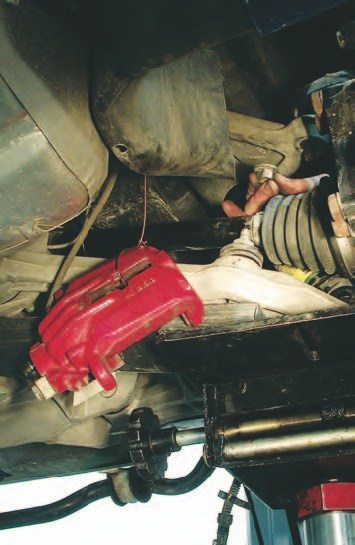 10. Hang the calipers on the lower control arms with some welding wire, zip ties, or a wire hanger, so the brake lines aren't supporting the calipers.