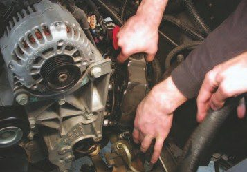 33. Now, swing the power steering pump towards the inner fenderwell to clear the engine. Use wire or zip-ties to hold it in place until it's time to reinstall the engine.
