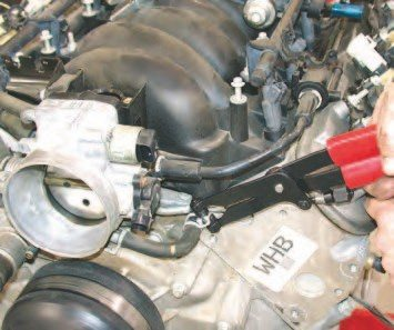 2. On the LS1 and LS6 intakes, the throttle body is connected to the cooling system by a water hose, which heats the body for improved start-up performance. To remove the hose, use pliers to release the clamp and a screwdriver to work the hose off the tube, or you can use one of these cool clamp/hose pullers from Snap-On.