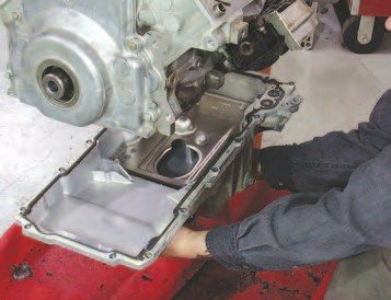 30. Once you bolt the oil pump back into place, you can reinstall the oil pump pickup. Apply a light coat of lube to the o-ring before installing. then, use some red Loctite and torque the 8-mm fasteners on the oil pump to 18 ft-lbs and the 6-mm nut on the center main stud to 106 in-lbs.