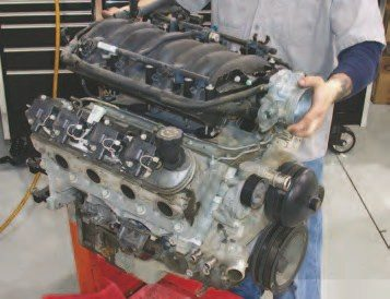 42. Install the LS6 intake manifold with new gaskets (available from GM, SLP, and other parts houses). This brings up a good point: don't reuse any Gen III V-8 gaskets because they are all of the compression-carrier design. This means the aluminum surface of the gasket takes the torquing load to control how much compression the embedded silicon sealing surfaces experience. This maximizes sealing control and minimizes the need for retorquing to maintain the clamping load – but they are one-use items.