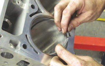 1. Setting the proper ring gaps is critical if you want your engine to make good power, last a long time, and not burn excessive amounts of oil. The following is a complete breakdown of the process of setting ring gaps for a traditional ring pack. The first step is to set the first or second ring gently in the bore it will be used in.