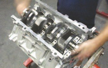 2. Once you place the crankshaft in the engine, it's a good idea to spin it over to make sure it clears the engine block and there is no binding. If there are no issues, you can continue with the installation process. If there is interference, stop and check the bearing clearances again. Issues usually have to do with the overall crank diameter and the thrust bearing clearance.