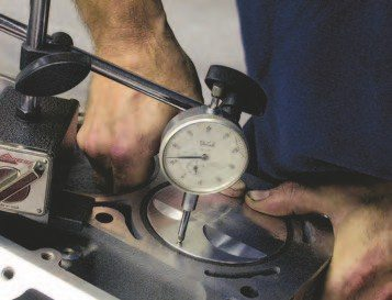 2. Now, push on the other side of the top of the piston and read the dial indicator.