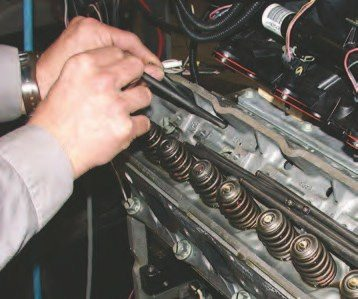 13. Reinstall the pushrods with a light dab of extreme-pressure assembly lube on each end of the pushrods, bolt the rockers back into place and select pushrods to achieve a valve lash of 1/2 turn (see Chapter 9 for more detail on this), and reinstall the valve covers and coil packs.