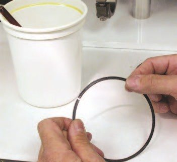 "4. Before installing the pistons, W2W wipes the face of the top and second rings with a light coat of 30-weight oil dripped on the fingers. They then wipe the rings with a non-linting towel before installation. Using a light brush, the oil ring lands are lightly covered with 30-weight oil, and then wiped with a non-linting towel to remove any excess oil. You need to remove the excess oil to prevent it from ""cooking"" into the ring lands upon startup, which could prevent the rings from sealing properly."