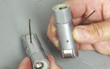 1. Lube the cam up with engine oil and install it (for cam installation tips, see pages 93-94). The next step is to soak the Jesel solid roller lifters in engine oil before you install them. The tip here is to make sure the lifter is installed with the open oil feed hole exposed to the main oil galley. The Jesel lifters have two holes 180 degrees apart: one that is open and another that is blocked off. The way to make sure you are installing the lifter correctly is to plunge a small Allen wrench in there to make sure you have the open hole in the right spot.
