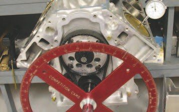 2. To check the degree wheel location to the piston location, rotate the crank 360 degrees to get the piston to 0.050 inch before TDC on the number-1 piston, as shown. Note that the degree wheel is showing 12 degrees approaching TDC. The 0.050-inch value is used to ensure the tolerances in the components don't affect the readings.