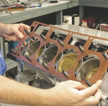 3. Since this engine is going to run above 20 psi of boost, we're using a coated copper gasket with a steel oring in the deck surface. Copper gaskets are for full-out engine combinations because they don't have as much give as composite gaskets, but the clear coating does improve their sealing capability over older uncoated copper gaskets.