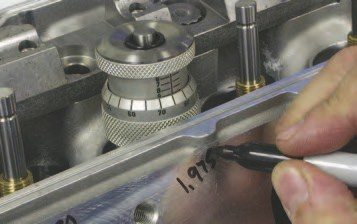 7. To avoid valvespring coil bind, it's a good idea to check the required valvespring height. You can do this with a valvespring height checker, shown, or a micrometer.