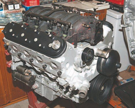 This 5.3L aluminum long-block became my test engine. It came out of a 2005 Chevy Silverado with 130,000 miles for the paltry price of $550, complete from oil pan to intake, minus front-drive accessories. I haven't touched the shortblock itself and have replaced only the timing chain and the oil pan with an F-Body pan to fit the application where it will rest later in its life.