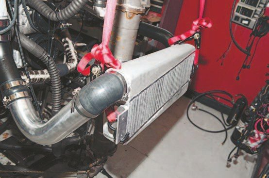 I hung the air-to-air intercooler in a likely location using a spare set of ratchet straps as a crude temporary bracket.
