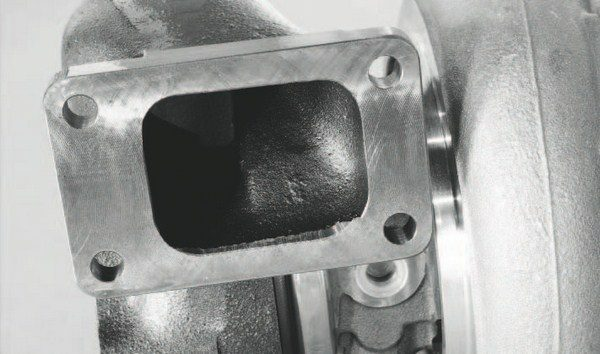 Like the exhaust manifolds in a turbo system, the turbine side of a turbocharger is typically constructed of thick cast iron. The mounting flange seen here reveals a thick pad to resist warping.