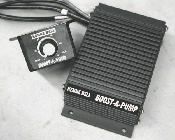 Here is a typical Boost-APump installation. Installation is fairly simple: It is wired into the existing power wire that leads to the fuel pump, with additional wiring leading to the driver-adjustable control knob. On this Corvette, the driver's-side rear wheel well liner was removed to mount the unit. The re-installed liner provides weather protection.
