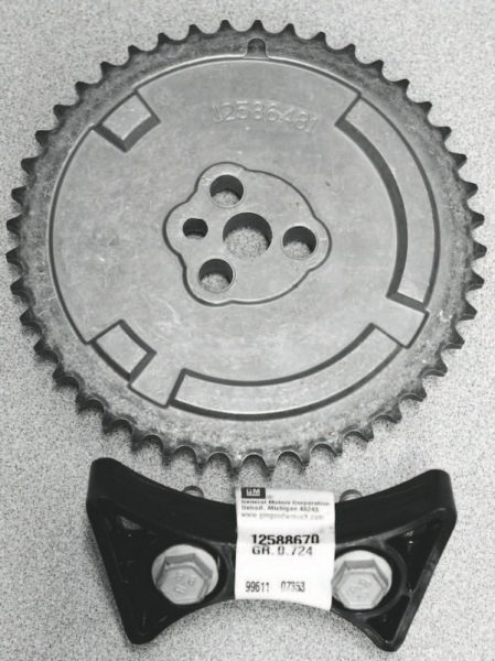 Because the replacement camshaft used here features the three-bolt cam gear fastening design of earlier LS engines, the stock single-bolt gear could not be re-used. A three-bolt gear was obtained, along with a replacement timing-gear guide that replaces the more cumbersome stock tensioner.
