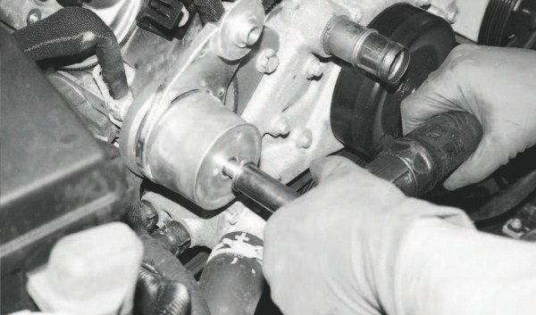 Many of the installation procedures simply prepare the engine to accept the supercharger. Such is the case with this step: adding a new tensioner/ pulley to the front of the engine, as the crankshaft-driven supercharger adds a pulley to the accessory drive system. Not seen here is the pulley that bolts to the tensioner bracket after the bracket is secured on the engine.