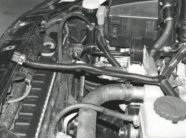 Here's the extended harness assembly, with the wires tucked back inside a longer cover. When done correctly, the modification looks factory, with the cleanly spaced extension joints fitting easily within the cover. The extension is required to accommodate the modified mounting position of the throttle body when it is installed on the supercharger, as well the additional reach required for it around the supercharger system's components.