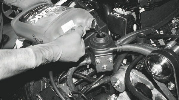 With all of the charge-cooling system's hoses securely connected, the reservoir is filled with a 50/50 mix of coolant and water, just as in the engine. Depending on the system, it takes 1 to 2 gallons of mixed coolant. Activating the pump without the engine on helps circulate the coolant to quickly fill the system. This is also the appropriate time to refill the engine radiator with the coolant that was drained previously