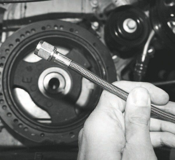 After pinning the crankshaft, an oil-feed line was routed from the engine in preparation for the supercharger. Some centrifugal superchargers (Vortech blowers, mostly) require this external lubrication. The oiling circuit also includes an oil return line that must be tapped into the oil pan. (See Chapter 4.)