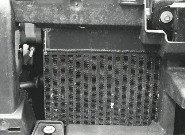 The other major component of the turbo system is the intercooler, which includes a custom heat exchanger built by Stenod Performance. It's an air-to-air intercooling system, meaning the pressurized air from the turbo system simply flows through the exchanger and is cooled by air entering through the grille or from the electric cooling fans. There is no liquid coolant circulating in the heat exchanger, as would be the case with a liquid-to-air intercooler. Stenod started with a Bell core and built the inlet/outlet caps to fit the Trail- Blazer. It mounts to a removable header that's part of the TrailBlazer's radiator core support, making installation and removal very simple.