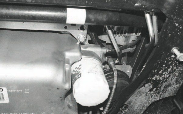 An oil-feed line for the turbo is added at the oil filter mounting pad, tapping into an existing, but unused port. A return line is also required and routes back through the oil-fill hole in the valve cover. An electric pump scavenges the oil from the turbo, forcing it back into the engine.