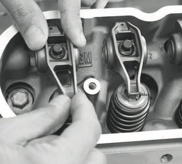 Surprisingly, no production LS engines use roller-tip rocker arms; they're all stamped-steel, flat-tip rockers. Later, rectangular-port heads use offset intake-side rocker arms (as seen here) that accommodate the valve position for both the large valve heads and the large ports within the head. Beehive-style tapered valvesprings are LS-standard, too, but don't stand up well to the increased pressure from a higher-lift cam or the cylinder pressure of high boost.