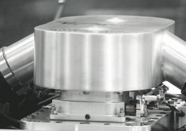 The boost generated by the turbochargers is pushed into this custom plenum atop the engine. Air is funneled through it and a pair of 2,100- cfm ACCEL/DFI throttle bodies before flowing down into a tunnel-ram-type intake. The entire intake system was custom fabricated, with the lower tunnel-ram section CNC-milled by GM and the upper plenum and intake tubes built by Thomson Automotive.