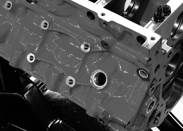In addition to containing the violent forces associated with internal combustion, a block must also resist the stress imparted on its exterior by the engine mounts as it rocks from side to side under acceleration, deceleration, and in corners. Stock and aftermarket LS blocks incorporate stiffening ribs between the engine mount bosses to minimize deflection.