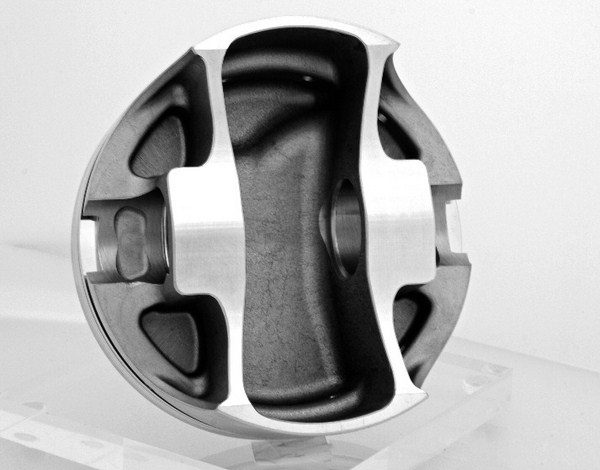There's more to piston strength than just metallurgy. Pistons designed specifically for power adders feature thicker crowns and wrist pins and more structural stiffening to resist deflection. (Photo courtesy of JE Pistons)