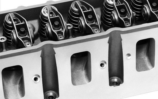 Taking cues from the C5R race heads, GM was able to increase the port volume and cross-sectional area of the LS7 heads by moving the intake pushrod over to the side. That allowed for a more conventionally shaped rectangular intake port.