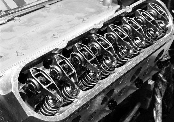 Some aftermarket heads slightly alter the factory valve location. This requires a custom stand bolted between the rocker arm bosses and the rocker arms, which are supplied with the cylinder heads, to maintain proper rocker-tip-to-valvestem geometry. (© GM Corp.)