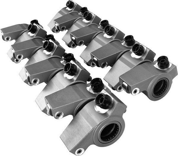 In a stud-mount rocker arm arrangement, the stud bears the brunt of the load imparted by the valvespring and pushrod. In a shaft-mount rocker system, the rocker pivots around a central shaft that's bolted to the cylinder head. With this setup, the shaft absorbs most of the valvetrain load, reducing deflection and increasing durability and high-RPM stability. (Photo courtesy of Comp Cams)